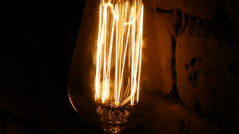 Bulb close-up. The light flashes. Vintage lighting decoration. Classic edison Footage
