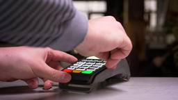 Close-up shot of man swiping credit card through terminal machine performing Footage