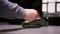 Close-up shot of man attaches credit card to terminal performing successful Footage