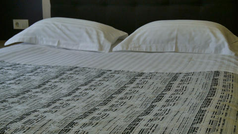 Double bed in the hotel room. Decoration in bedroom interior Stock Video Footage
