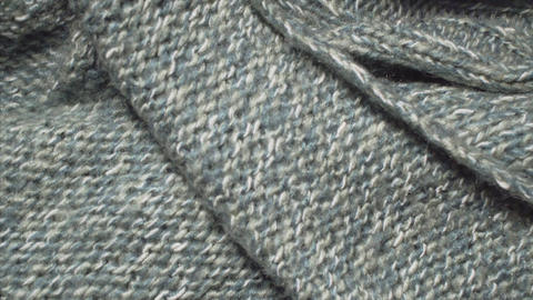Detailed shot of a green colored knitted sweater ビデオ