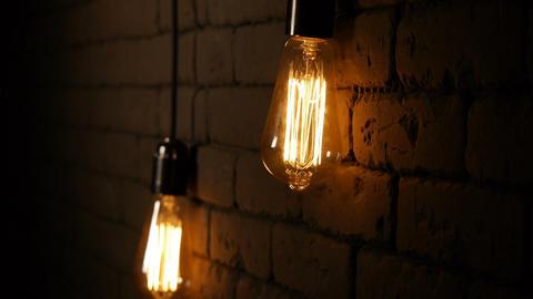 Vintage lighting decoration. Classic edison lamp. Hanging light bulb. Close up Footage
