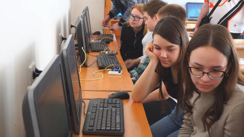 Students in front of computers in a computer class Footage