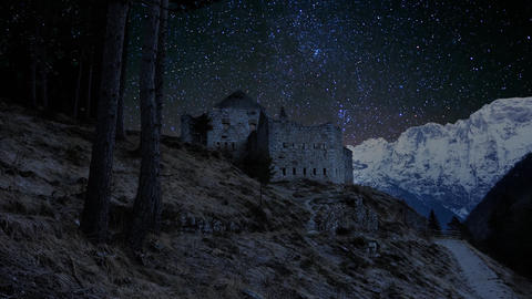 Timelapse - Night sky, stone building ruins and beautiful snow-capped Alps Footage