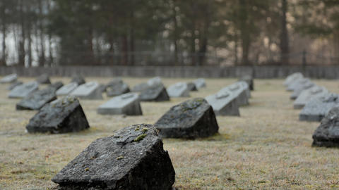 Timelapse - Sunlight shines on memorial headstones of deceased soldiers ビデオ