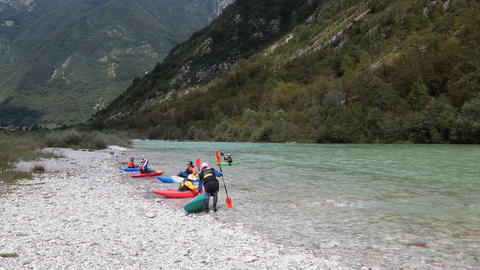 Timelapse - Kayaks on the river next to a steep hillside Footage