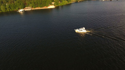 Aerial View:motor Boat Floats On The Lake stock footage