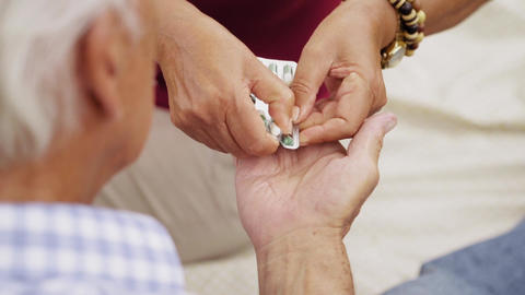 12-Slowmotion Senior Man Grandpa Taking Medicine Pill For Heart Footage