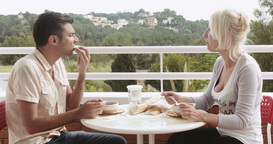 Couple having lunch on the balcony Footage