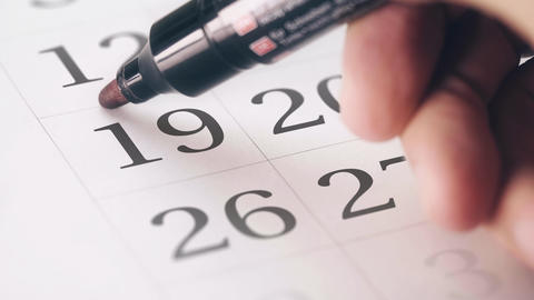 Drawing red circled mark on the nineteenth 19 day of a month in the calendar Footage