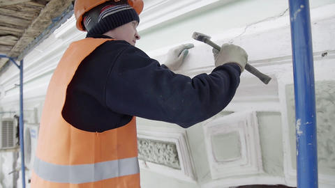 Worker with protective gloves uses small hammer for... Stock Video Footage