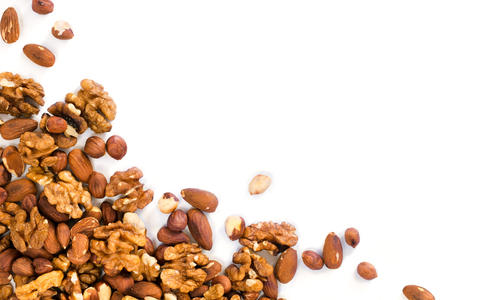 Background of mixed nuts with copy space Photo