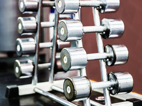 Stand with dumbbells in gym Photo