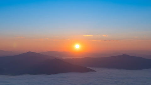 Beautiful nature landscape of sunrise over the mountain and fog, timelapse Live Action
