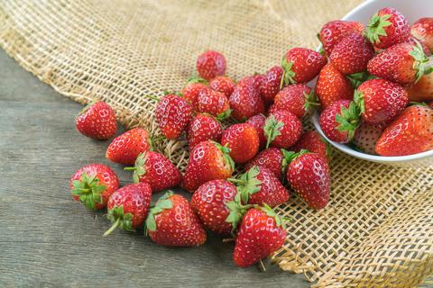 Fresh strawberry fruit on wood table Photo
