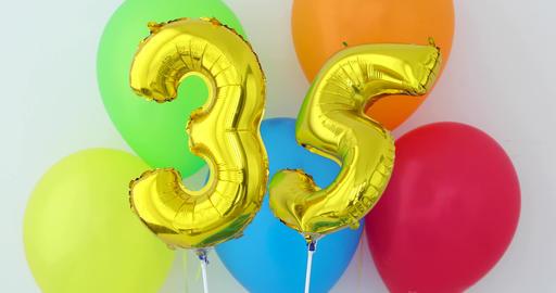 Gold foil number 35 celebration balloon on a color Footage