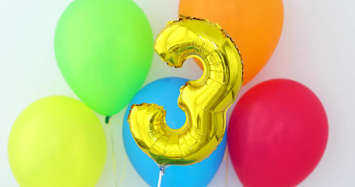 Gold foil number 3 celebration balloon on a color Footage