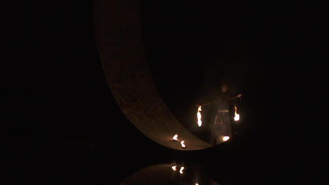 Amazing circus artist makes danger fire show, he spins poi in slow motion Live Action