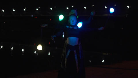 Circus artists man and woman in black suits that spin the led poi Footage