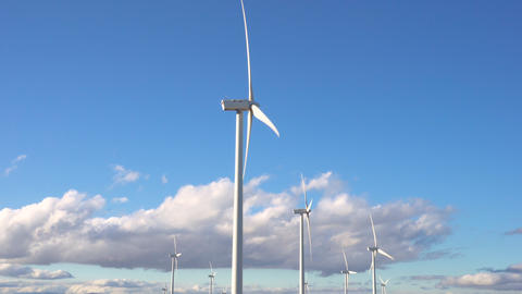 Wind energy turbines on blue sky background, sustainable ecological energy Live Action