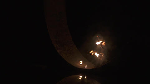 Alone circus artist makes danger fire show under the bridge in slow motion Footage