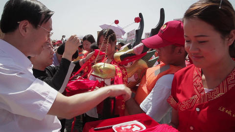 XI'AN - JUN 12: People decorate head of dragon before traditional dragon boat Live Action