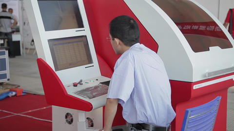 XI'AN - AUG 29:View of worker operating machine, Aug 29, 2013, Xi'an city Footage