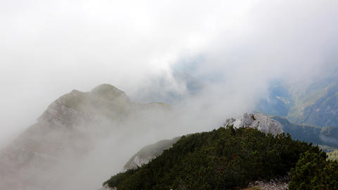 Timelapse - Clouds rolling over the mountain peaks Live Action