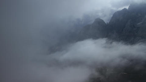 Timelapse - Clouds blocking the view towards the mountain landscape Footage