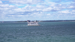 A historic paddle boat carries tourists on Boston Harbor Footage