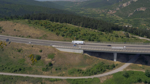 Aerial - Tracking shot of a truck tractor with blank white semitrailer Footage