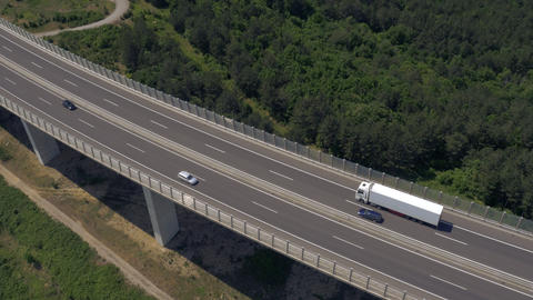 Aerial - Flying above the viaduct, tracking some traffic Live Action