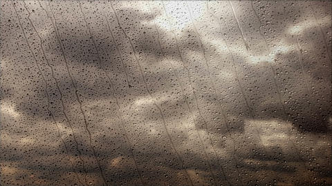 Storm clouds flying fast through the rainy window, wide angle view Footage