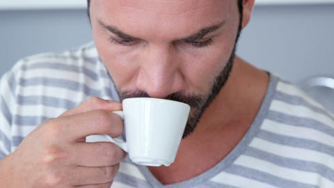 Man drinking an espresso and using tablet Live Action