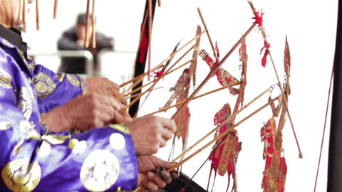 XI'AN - FEB 24: Folk artists of Chinese shadow play troupe playing accompaniment Footage