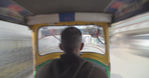 Tourist zooming in busy streets of Varanasi sitting inside auto rickshaw Footage
