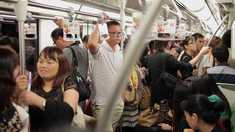 SHANGHAI, CHINA - Sep 06 2013: People travel on the busy subway during morning Live Action