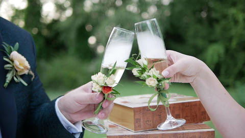 The bride and groom give luck with champagne glasses Live Action