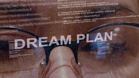 Dream plan text on background of female developer Footage
