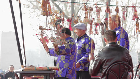 XI'AN - FEB 24: Folk artists of Chinese shadow play troupe playing accompaniment Live Action