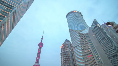 Night traffic and tall buildings in Shanghai from day to... Stock Video Footage