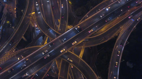 Aerial view of highway junctions shape letter x cross at night. Bridges, roads, or streets in Live Action