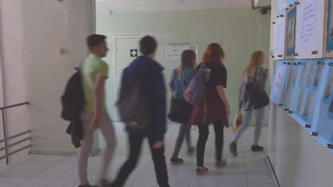 Students walk down the corridor of the College Footage
