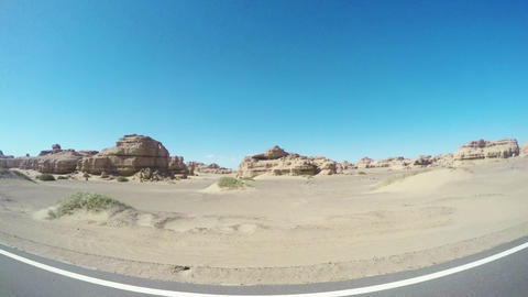 View of car driving in Yardang Landform Gansu, China Live Action
