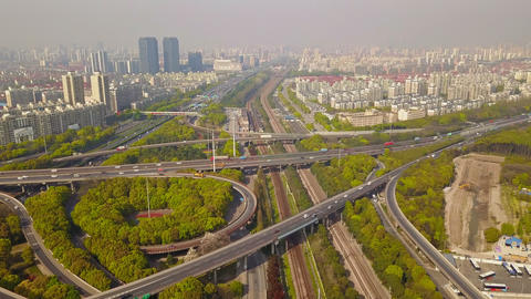 Aerial view of cars on highway junctions with green trees. Bridge roads or streets in structure of Footage
