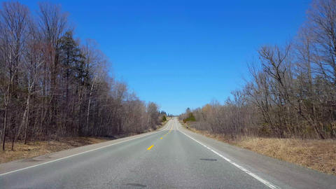 Driving Rural Countryside During Spring Day. Driver Point of View POV Along Beautiful Sunny Country Footage