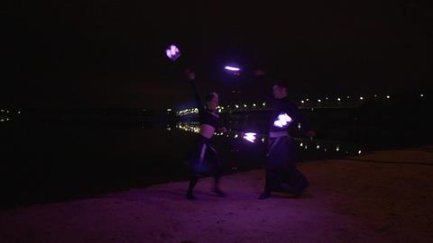 Two artists make led show on the bank of the river Dnipro in Kyiv at the night Footage