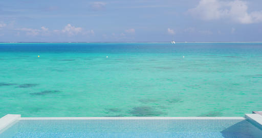 Infinity pool over tropical ocean coral lagoon travel vacation background Footage