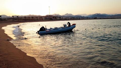 4k footage of motorboat on calm sesa waves at sunset light Footage