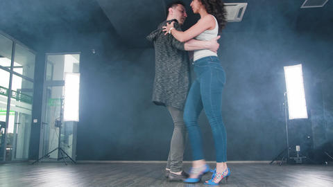 A man and a sensual woman dancing kizomba in a dance studio Footage